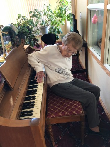 Lois showing off her piano playing skills