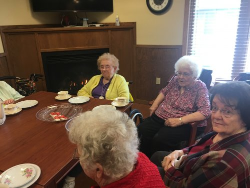 Ladies enjoying tea & cookies