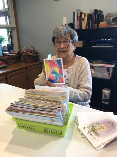 Mary picking out a card to send to her daughter-in-law