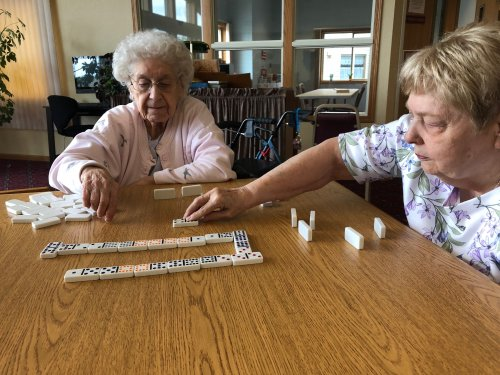 Bernice & Carol in a serious game of dominos!