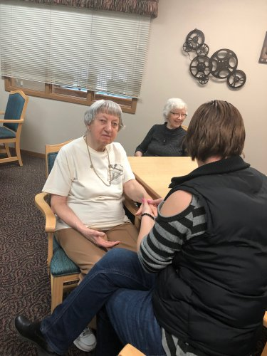 Alice getting her hand massaged while Mabel waits her turn! Such a fun, relaxing activity!