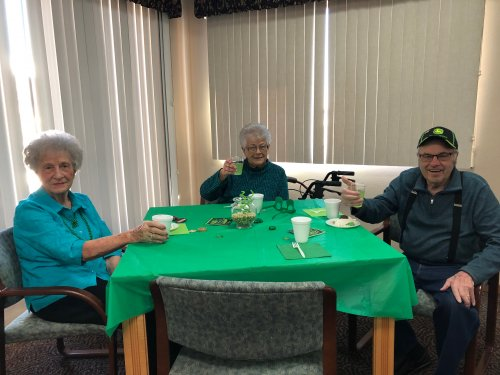 Kay, Delayne, and Merwyn raising their glasses or green punch at our St. Patrick's Day party!