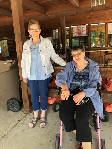 Mary, and LeeAnn waiting for the bus at the Zoo! What a beautiful day to be outside!