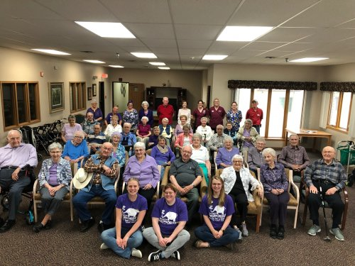 Residents and staff gathered for a group picture on the longest day! Many of the residents wore purple for Alzheimer's awareness!