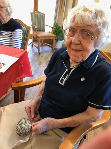 Dorothy showing off her yarn ball! She added so many beautiful colors to hers! Everyone's  turned out great!