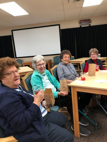Delores, Joanne, June, and Bernie enjoying their time together at Happy Hour!