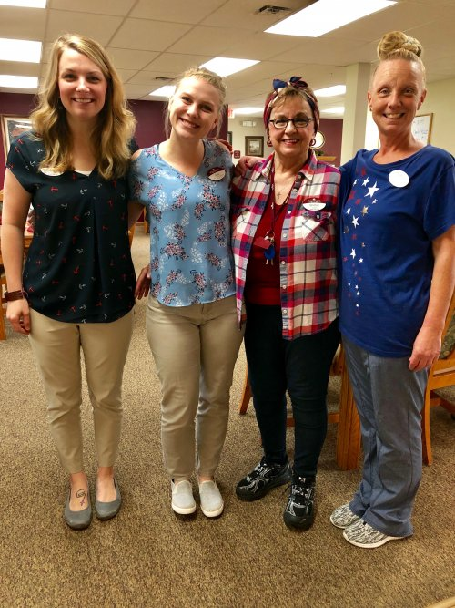 Staff wearing red, white, & blue to support our flag day theme for our Father's Day social today!