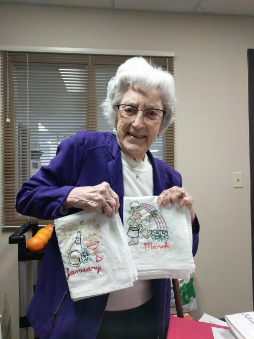 Mavis showing off her dish towels she embroidered. She made one for each month! They turned out amazing!