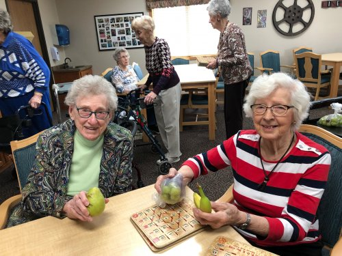 Vivian and Mabel With the fresh fruit they won at Bingo! Our residents sure love coming to Bingo!