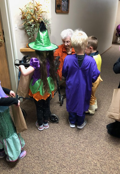Bertha handing our goodies to the Wilton Preschoolers! We were so glad they were able to come trick or treating today!
