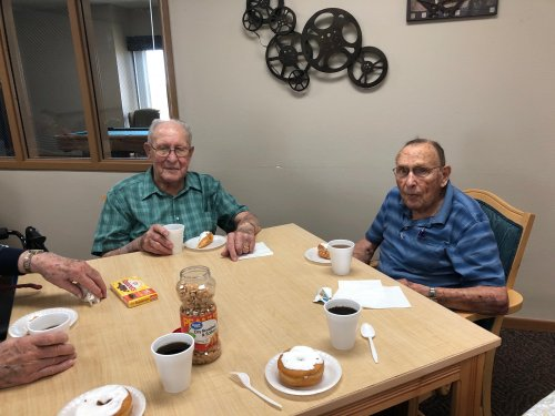 Roy and Les eating their doughnuts on national doughnut day! They were so yummy!