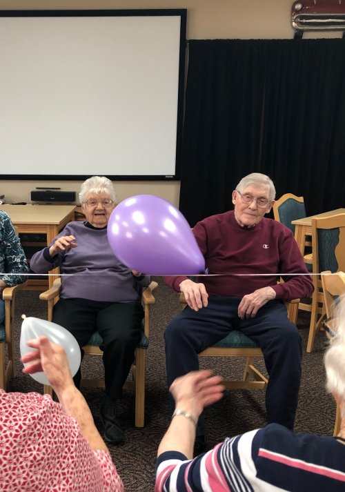 Rachel and Harold playing balloon volleyball! Such a fun way to get your body moving!