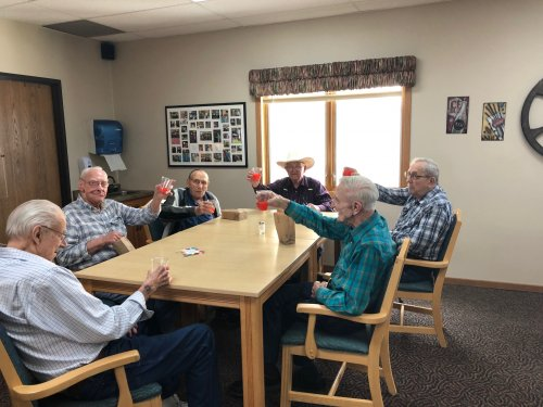 Fred, Bob M., Les, Clem, Louis, and Bob R. raising their glasses at happy hour! We have so much fun together!