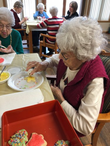 Mavis adding sprinkles to her beautifully decorated Christmas cookie! We had so much fun!