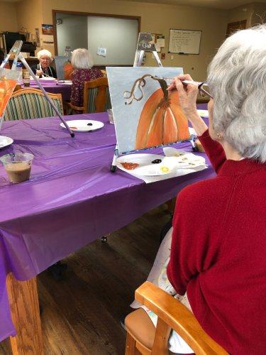 Mavis putting some of the finishing touches on her pumpkin painting! It was so great having Art From the Heart here!