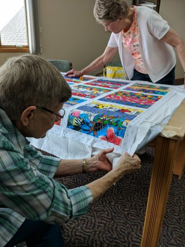 Aletha helping Katherine with a quilt for her great grandbaby! It's so nice that they are able to help each other out!