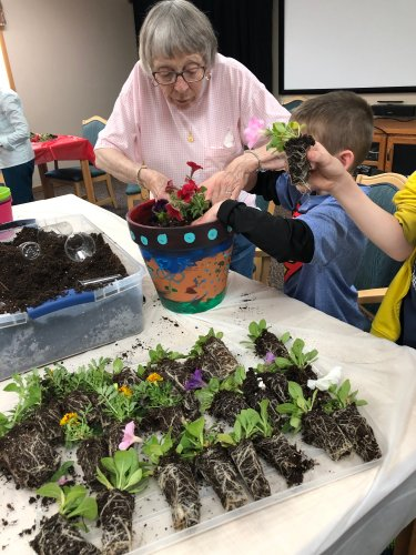 Virginia planting flowers with some kids from A local bible study! We had so much fun!