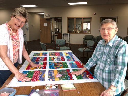 Katherine and Aletha working on a baby quilt together! Beautiful job ladies!