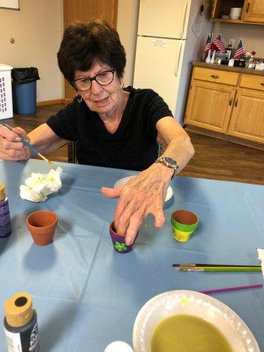Bernie painting her flower pot! You did a beautiful job, Bernie!