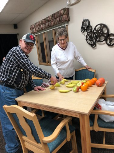 Clem and Mary picking out a piece of fresh fruit for their bingo prizes! Everything looks so tasty!