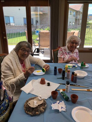 Virginia and Dorothy Painting their clay pots! They did such a wonderful day!