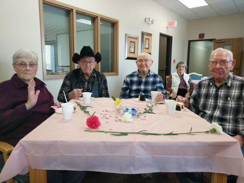 Anna, Clem, Harold and Bob had a great time at the Valentine's party. Everyone received a flower and loved the entertainment.