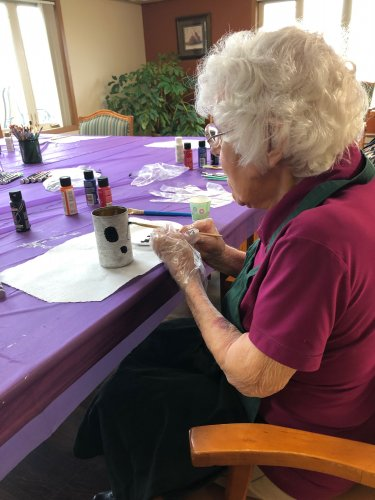Dorothy did a great job painting a ghost on her can! We are going to use the cans for a game at our Halloween party this month!