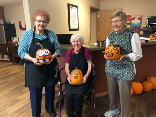 Mary, Dorothy, and Aletha With the pumpkins they painted! Its so fun to see what they will come up with each year!