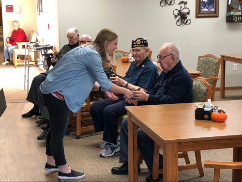 Amy (LEC) handing out gifts to our veterans! We are so lucky for all these guys have done!