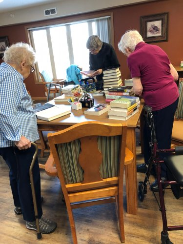 We sure love when the book mobile comes! Marilyn, Virginia, and Dorothy are searching for their new favorite book!