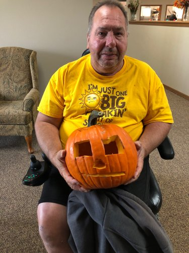 Jeff with his pumpkin he carved! Great job Jeff!