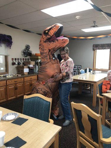 Katherine & one of our our staff members at the Halloween party! Katherine's great-grand LOVES dinosaurs so naturally we had to get a picture of them together