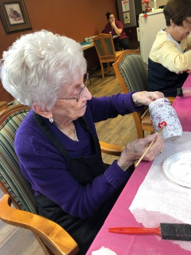 Bertha painting jars for our new centerpieces! Wonderful work!