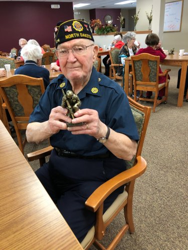 Harold with his Solider statue that he got for veterans day!