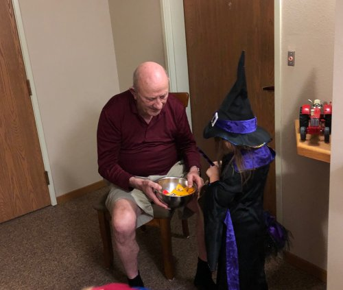 George handing out candy to a witch! we had so much fun with the Wilton Preschoolers this morning!