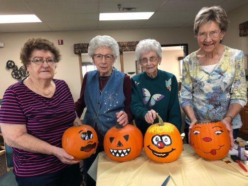 Deloris, Mae, Bertha, and Katherine with their pumpkins they painted! Wonderful work ladies!
