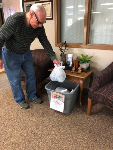 Bob adding some nonperishable food items to our food drive bin! We have the best residents that are always willing to help others!