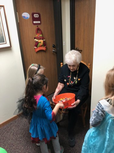 Pat Handing out candy to our trick or treaters! It's so fun to see all the costumes the kids come up with!!