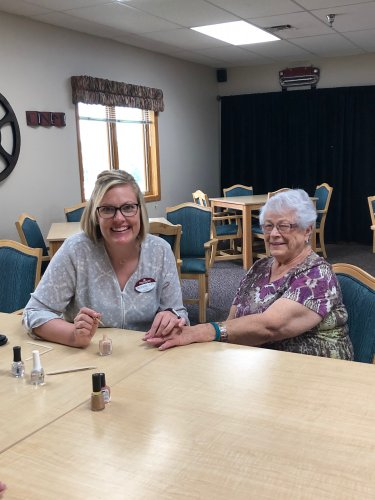 Michelle(ADON) painting DeLayne's nails at ladies hour today! We have so much fun together!