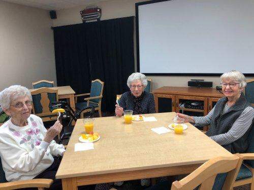Bertha, Mae, And Shirley enjoying their mimosa's and Fruit!