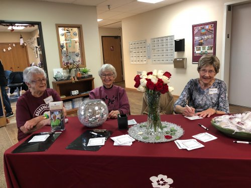 DeLayne, Shirley, and Katherine at the greeters table at our 25th anniversary party! they did such a wonderful job welcoming everyone to our community!