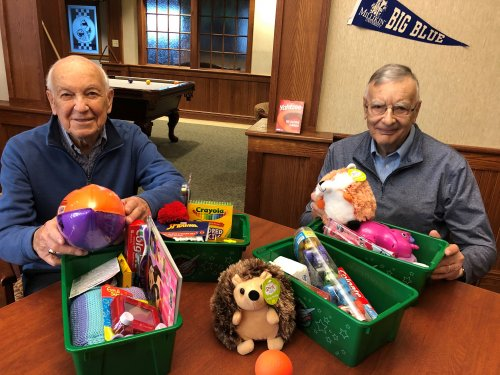 John and Jack help pack the shoe boxes for Operation Christmas Child