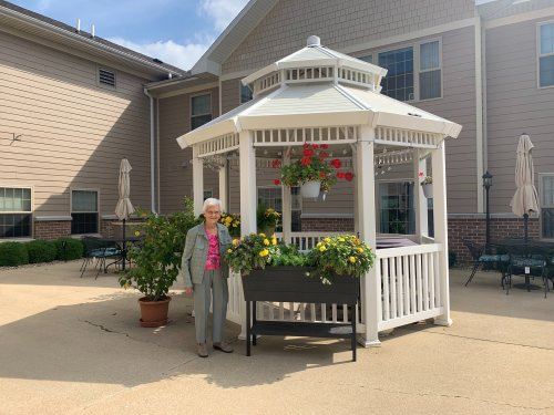 Waneta 101 years young proudly shows off the flowers she has been taking care of all summer!
