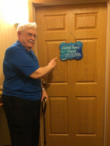 Waymond is showing off the art work on his front door made by his precious  granddaughter