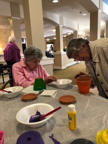 Martha and Ina decorating their flower pots