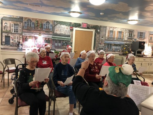 The Primrose Choir performed for the annual family Christmas Party