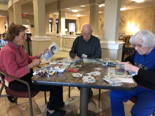 Decatur residents working hard to clip coupons for our troops and their families over seas.