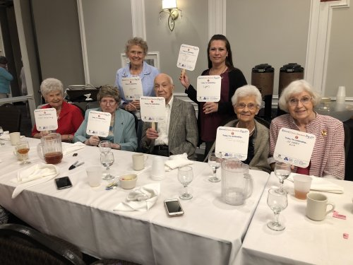 Administrative Assistant Stephanie and several residents celebrate 148 years between them cancer free at the annual Cancer Survivors Dinner.