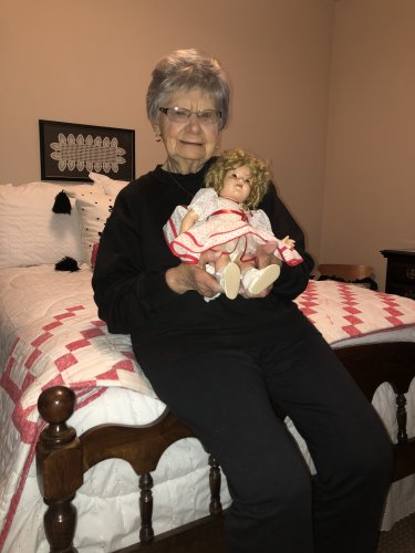 Mary holding her 84 year old Shirley Temple doll when she received when she was only 10 years!