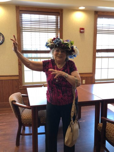 Helen thought she was a Hula Dancer when she decided to wear her wreath she made